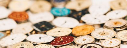 Old fashioned retro little wrist watch rusty dials with hands close up view web site header banner image stock photo