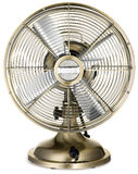 Old fashioned retro silver and brass desktop fan Royalty Free Stock Photo