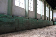 Old fashioned riding hall with sandy covering without people Stock Photo
