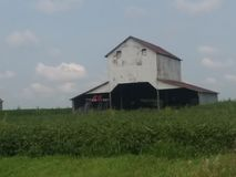 Iowa Barn. Vintage barn storage building out in a middle of a farm filed out in the country during the summer in Iowa stock images