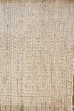 Old-fashioned rustic homespun cloth as background Stock Photography