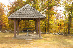 Old fashioned rustic wooden gazebo with a picnic table Stock Photo