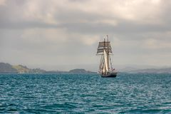 Sailboat On Empty Seas. Old fashioned sailing ship goes forth into the unknown ocean Royalty Free Stock Image