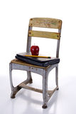 Old Fashioned School Chair with Laptop Royalty Free Stock Image