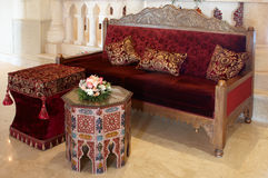 Old-fashioned set of furniture. Antiquarian red  ottoman with pillow Stock Images
