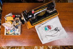 Old Fashioned Sewing Machine and Supplies on Table Royalty Free Stock Photo