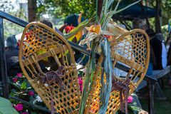 Old fashioned snow shoes, corn cobs and hay being displayed royalty free stock photos