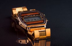 Old-fashioned electronic wristwatch on black background. Toned Royalty Free Stock Photography