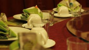 Old-fashioned Soviet style party, cheap cafe table decorated for celebration. Stock footage stock video footage