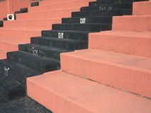 Old Fashioned Sports Seating. Hard concrete bleacher seats in an outdoor sports facility stock photography