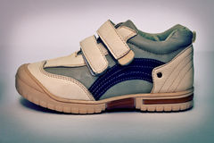Vintage sports shoes from synthetic leather royalty free stock photography
