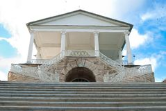 Old-fashioned stairway. Entrance to the museum with ancient stairs along the edges on the sky background Royalty Free Stock Photography