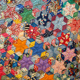 Old Fashioned Star Quilt. Multitude of colors and shapes. Very vibrant and unusual Royalty Free Stock Photography