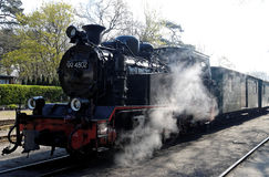 Old fashioned steam train 2. An old steam engine moving a train on the island of rügen in the east of germany Royalty Free Stock Images