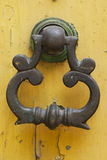 Old-fashioned steel knocker. Door decoration with old style holder Royalty Free Stock Photo