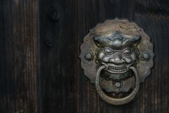 Old-fashioned steel knocker. Close up Stock Photography