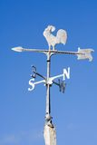 Old Fashioned Steel Weather Vane. An old fashioned steel weather vane isolated against a bright blue sky Royalty Free Stock Photography