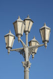 Old-fashioned street lamp. Saint-Petersburg. Old-fashioned street lamp against blue sky Royalty Free Stock Photography