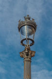 Old-fashioned street lamp against the sky. Royalty Free Stock Image
