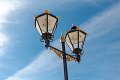 The old-fashioned street lamp, Gibraltar. The old-fashioned street lamp against the sky. Gibraltar stock images