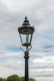 The old-fashioned street lamp, London, England. The old-fashioned street lamp against the sky. London, England stock image