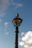 The old-fashioned street lamp, London, England. The old-fashioned street lamp against the sky. London, England royalty free stock photo