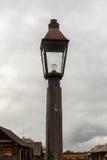 The old-fashioned street lamp,  Shushenskoye, Russia. The old-fashioned street lamp against the sky and   buildings.  Shushenskoye, Russia Stock Photo