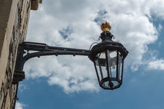 The old-fashioned street lamp, Windsor, England. The old-fashioned street lamp against the sky. Windsor, England royalty free stock images