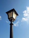 Old Fashioned Street Light. Against a Blue Sky ,Decorative street lamp-post . isolated on blue sky background Stock Photo
