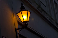 Old fashioned street light on wall  at night.Vintage lantern on Royalty Free Stock Photo