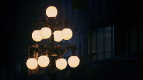 Old Fashioned Streetlight In Snowfall stock footage