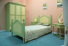 Old-fashioned style bedroom. Interior of Old-fashioned style bedroom Royalty Free Stock Images