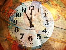 Old fashioned style stainless steel wall clock and globe.  Royalty Free Stock Photos