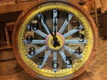 Wagon wheel and clock Stock Photos