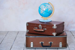 Old fashioned suitcases and global map Royalty Free Stock Photos