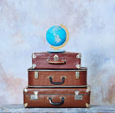 Old fashioned suitcases and global map Stock Photography