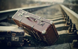 Old fashioned a suitcases on railroad tracks Royalty Free Stock Photography