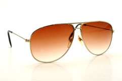 Old fashioned sun glasses. Isolated on a white background Royalty Free Stock Photo