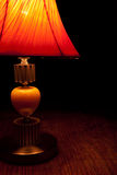 Old-fashioned table-lamp slightly lighten the darkness Royalty Free Stock Photography