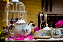Old fashioned tea set in the garden stock photography