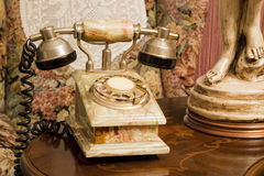 Old fashioned telephone. In a house Stock Images