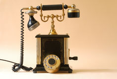 Old fashioned telephone. Retro telephone on yellow background Royalty Free Stock Photo