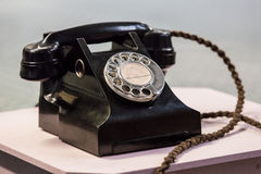 Old fashioned telephone. Old fashioned black telephone receiver royalty free stock photos