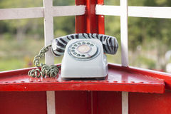Old-fashioned telephone booth Stock Image