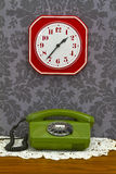 Old fashioned telephone and clock Stock Photos