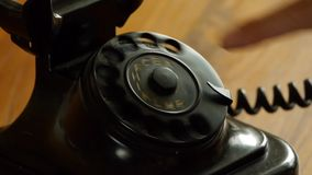 Old fashioned telephone - Man dials stock footage