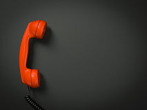 Old fashioned telephone. Receiver on cable isolated on a black Stock Photos