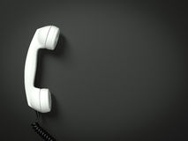 Old fashioned telephone. Receiver on cable isolated on a black Stock Photo