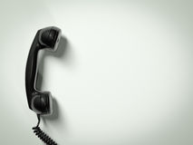 Old fashioned telephone. Receiver on cable isolated on a white Royalty Free Stock Photography