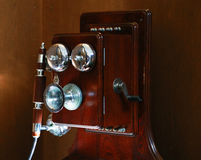 Old-fashioned telephone. Scenery of the old-fashioned wooden telephone Stock Photo